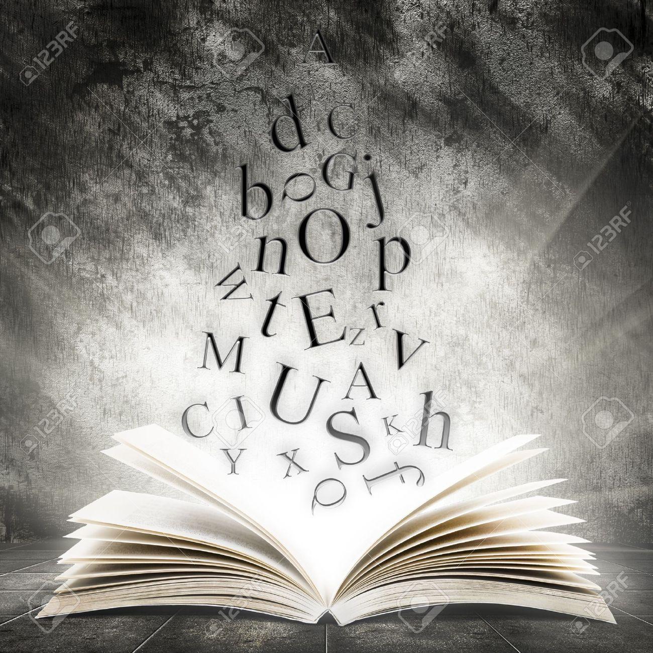 17665598-Vieux-livre-ouvert-avec-la-lumi-re-magique-et-lettres-qui-tombent-sur-un-fond-sombre-abstraite-Banque-d'images.jpg