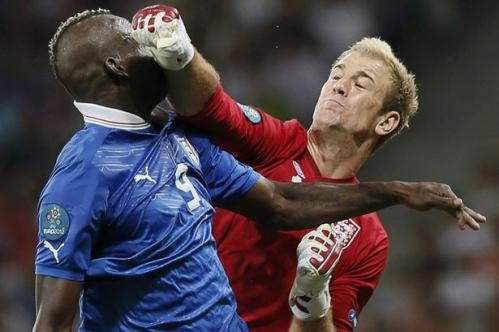 Mario Balotelli collides with England's Joe Hart.jpg