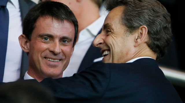 french-prime-minister-valls-and-former-french-president-sarkozy-attend-the-champions-league-quarter-final-first-leg-between-paris-st-germain-and-barcel.jpg