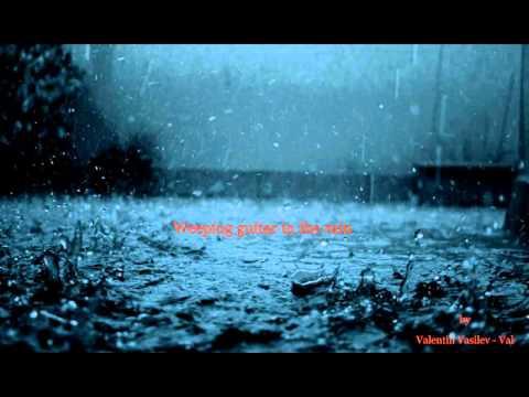 Valentin Vassilev Pleurant guitare Dans Le rain.jpg
