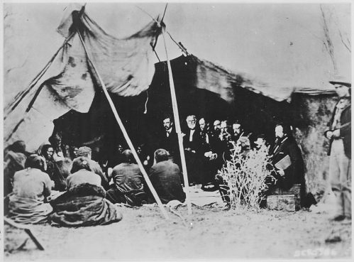 Photograph_of_General_William_T._Sherman_and_Commissioners_in_Council_with_Indian_Chiefs_at_Fort_Laramie_Wyoming_ca._1_-_NARA_-_531079.jpg