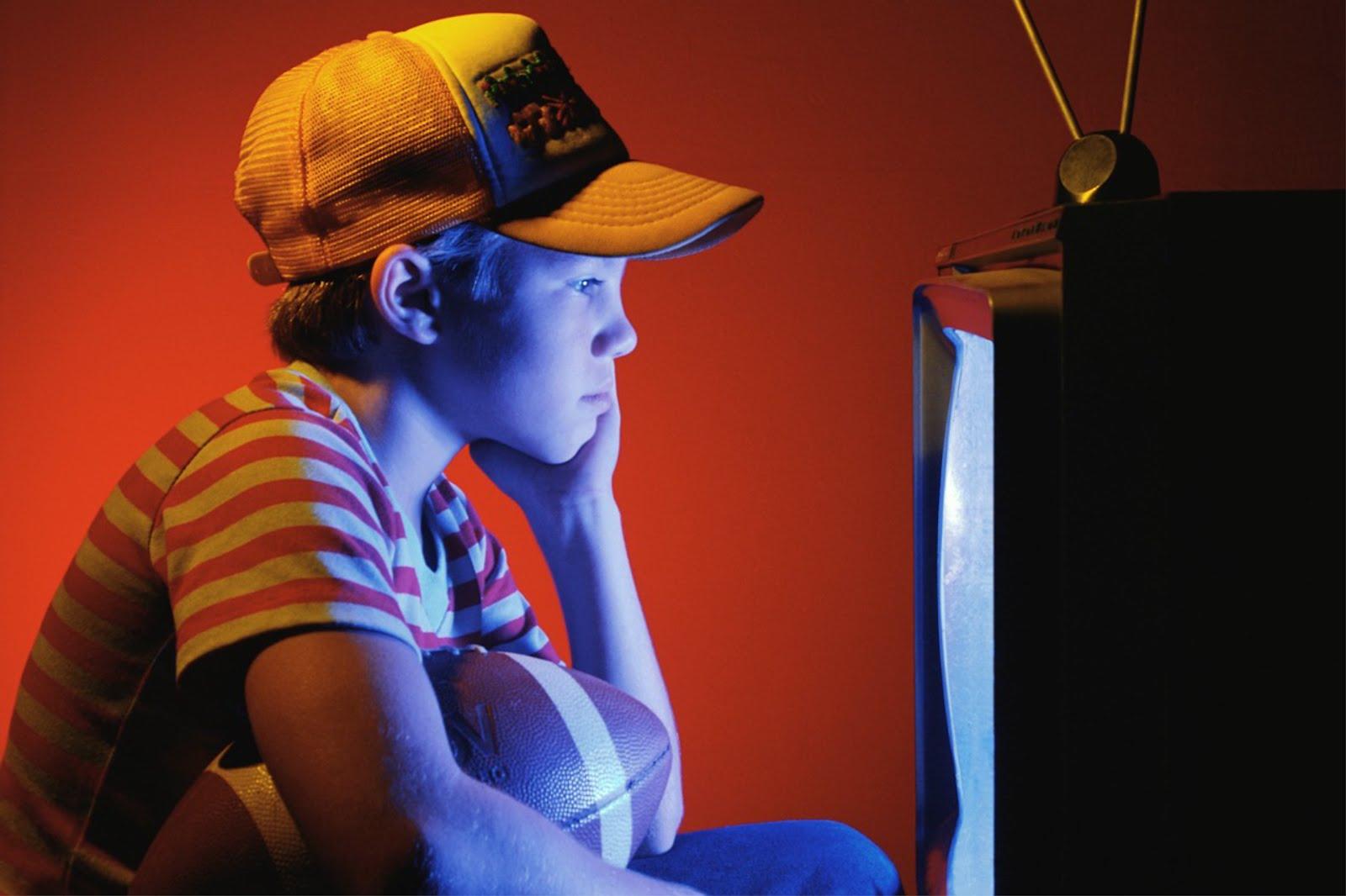 Boy up close watching television.jpg