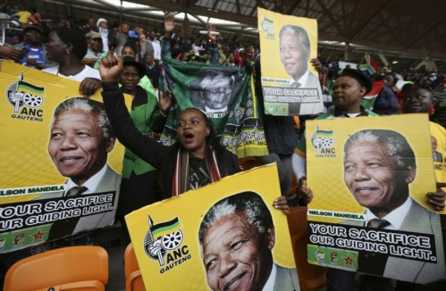 603589-people-hold-placards-of-former-south-african-presiden.jpg