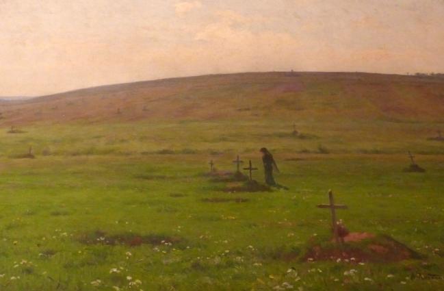femme devant une tombe sur une colline 1915.JPG