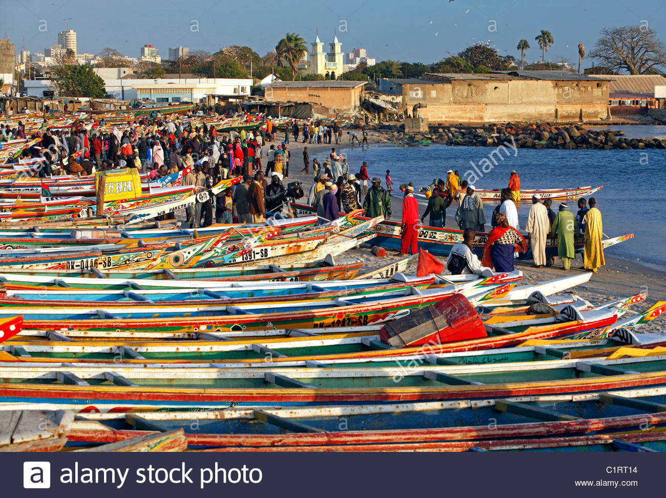 colorfully-painted-fishing-boats-line-the-beach-at-the-fish-market-C1RT14.jpg