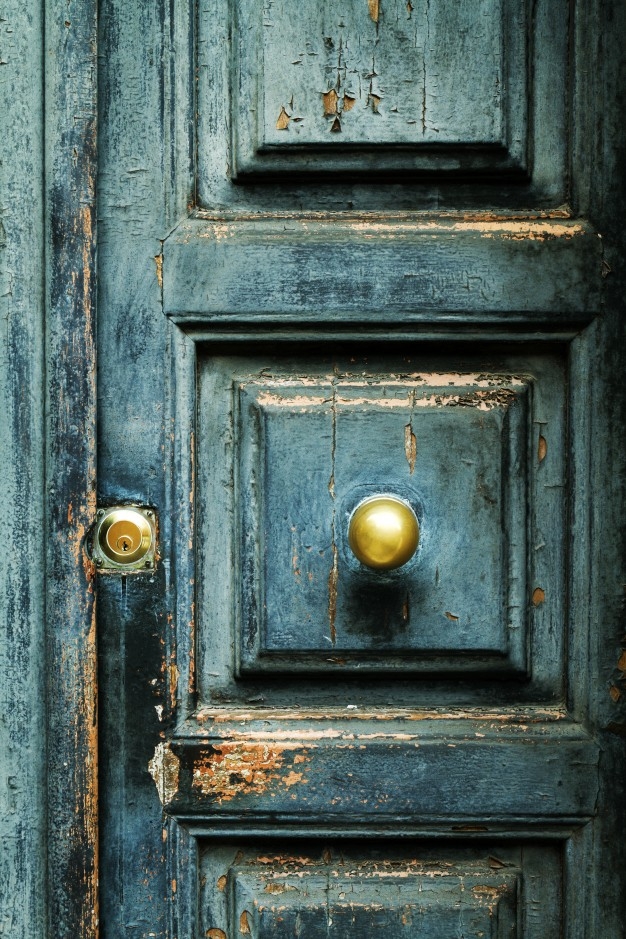 closeup-blue-turquoise-old-textured-antique-door-with-gold-br_1220-1252.jpg