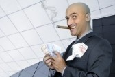 8519415-businessman-with-money-and-a-cigar.jpg