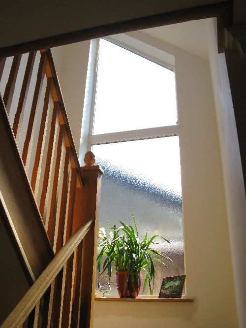 staircase and shaped window
