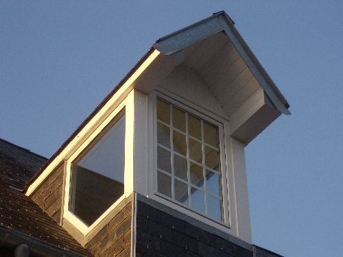 Finished dormer window with sidelights