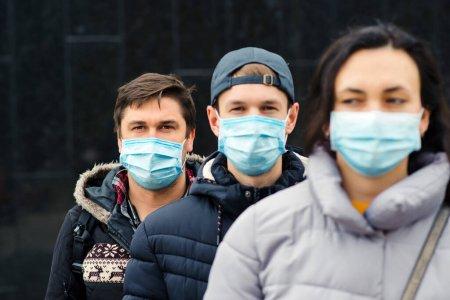 depositphotos_359566226-stock-photo-crowd-people-wearing-medical-masks
