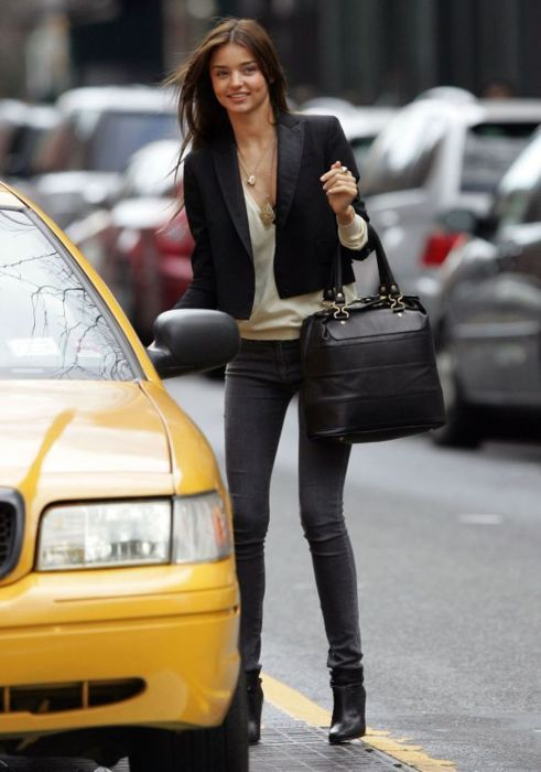 Miranda Kerr gray jeans and black blazer.jpeg