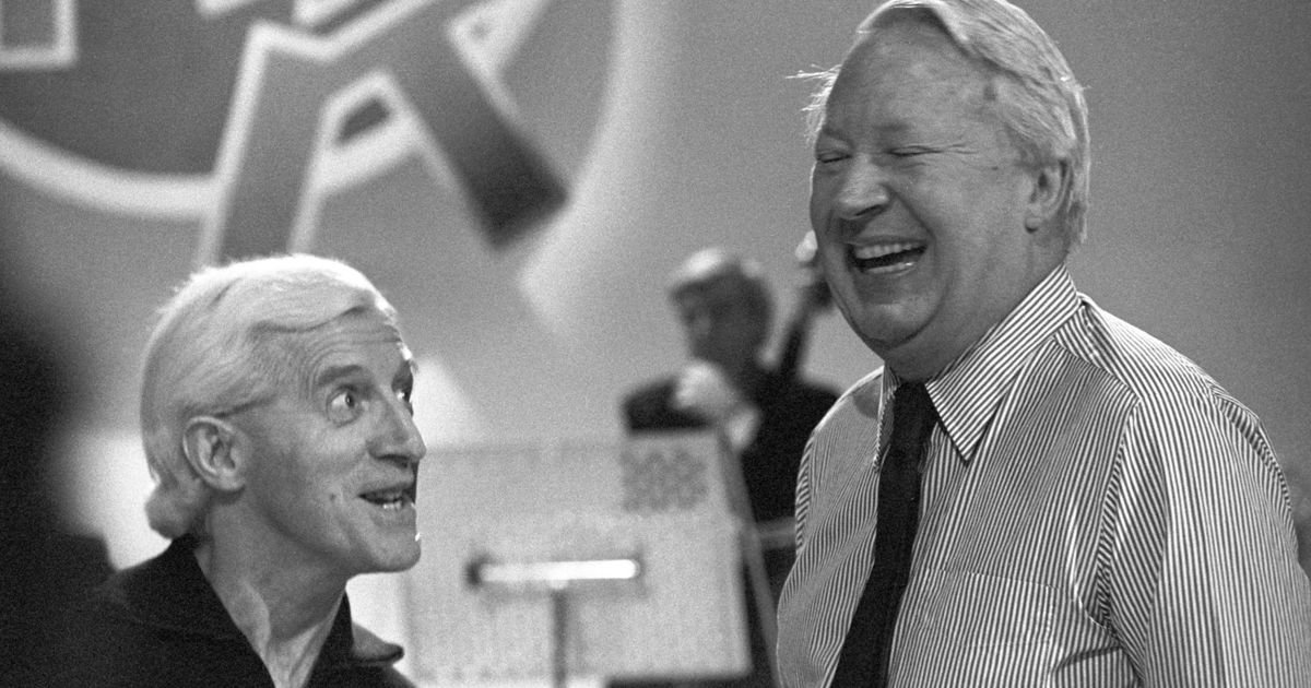 Edward-Heath-right-and-Jimmy-Savile-rehearsing-for-an-episode-of-Jimll-Fix-It.jpg