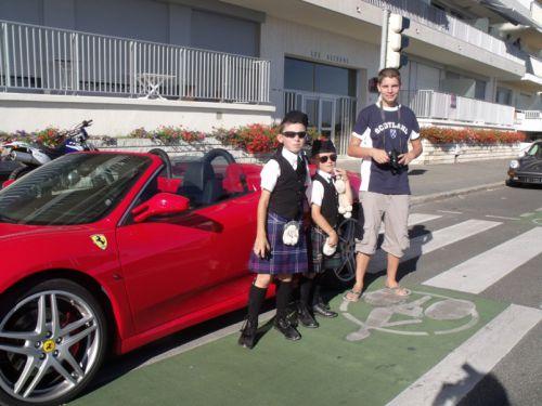 Ilan, Tom (the nice boys) and Swann (the bad boy) front a Ferrari
