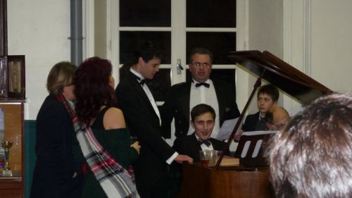 The director and junior faculty, singing