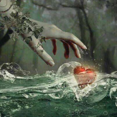 main qui essaie d'attraper un coeur.jpg