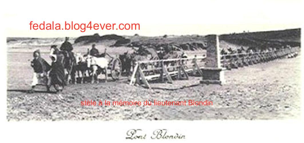 passage des troupes Françaises devant la stèle  du lieutenant Blondin