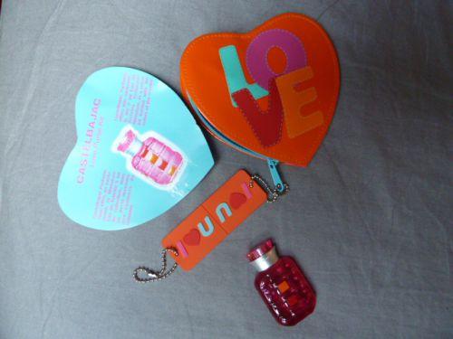 love purse kit eau de toilette 5ml avec un porte monnaie aux couleurs du créateur