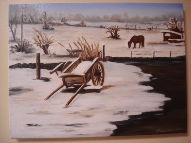 Charrette abandonnée dans la neige