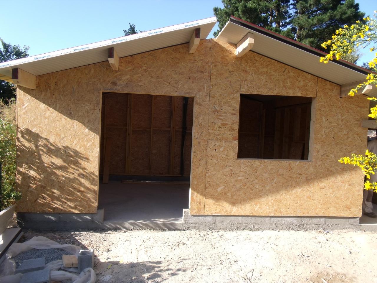 Fabrication et montage de garage et chalets en bois btp for Garage ossature bois prix