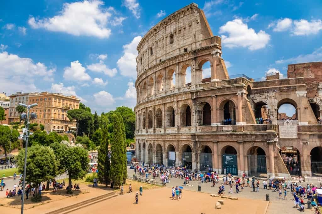 Colosseum-with-clear-blue-sky-Rome-Italy.-Rome-landmark-and-antique-architecture.-Rome-Colosseum-is-one-of-the-best-known-monuments-of-Rome-and-Italy-min.jpg