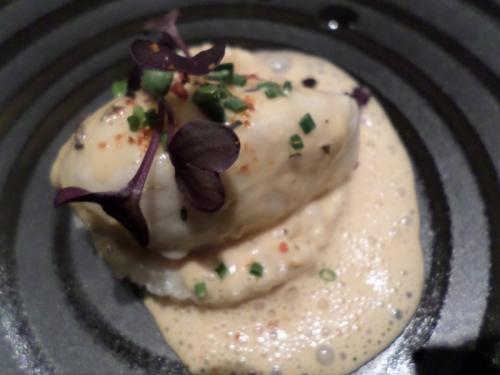 Quenelle de merlu avec un risotto et un crémet