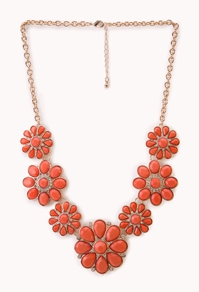 collier plastron 1290 euros oranfe et bleu.jpg
