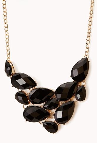 collier xxl plastron noir et or 1290 euros.jpg
