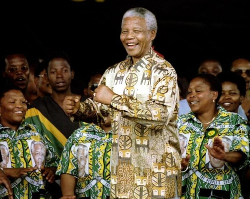 602541-south-african-president-nelson-mandela-dances-on-stage-october-29-during-a-rally-for-15000-supporte.jpg