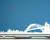 SYDNEY - Sticker: Sydney Skyline (Opéra, Harbour Bridge, Circular Q) avec des roches, des tours, des arbres et des étoiles
