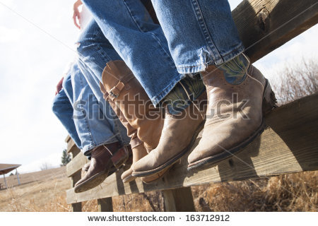 stock-photo-cowboys-and-cowgirls-sitting-on-wooden-fence-163712912.jpg