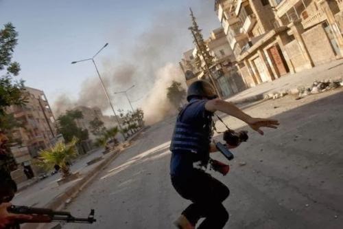 463499_un-photographe-de-presse-pris-dans-le-conflit-syrien-le-24-aout-2012-a-alep.jpeg