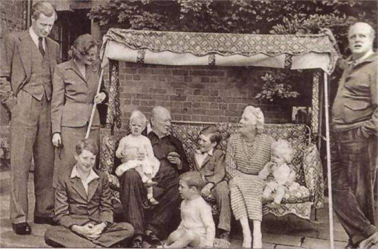 winston-churchill-on-a-swing-seat-chartwell-details-x500-c80-rmr-max-length.jpg