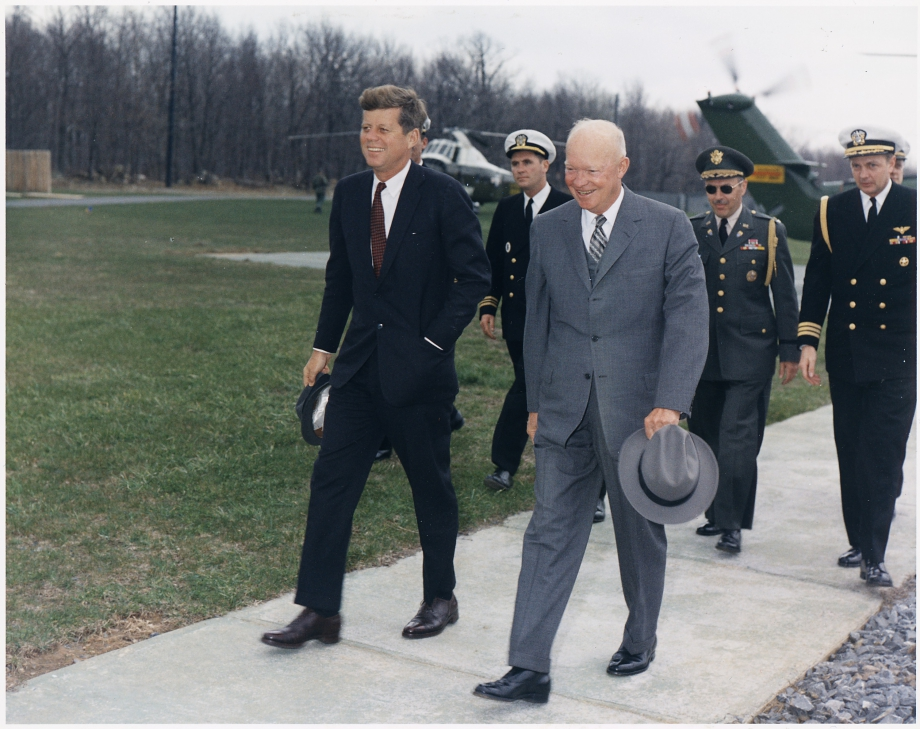Meeting_with_President_Eisenhower._President_Kennedy_President_Eisenhower_military_aides._Camp_David_MD._-_NARA_-_194198.jpg