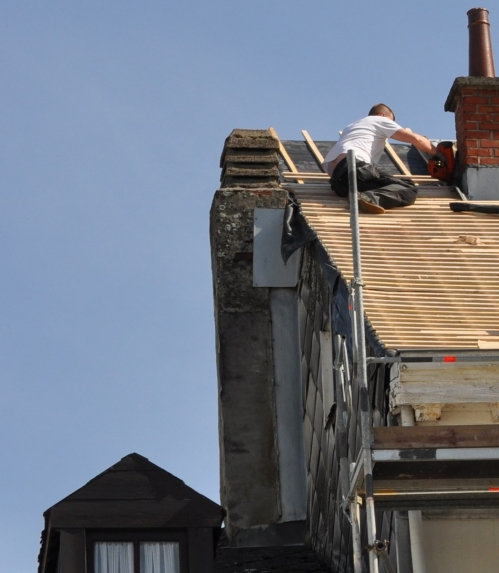 Working at edge of roof.jpg