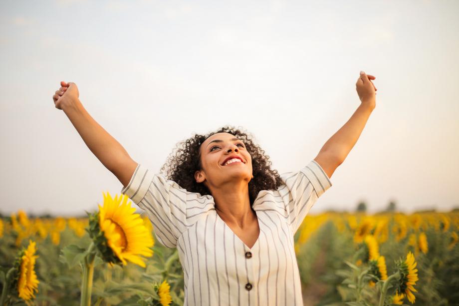 photo-of-woman-standing-on-sunflower-field-3756168.jpg
