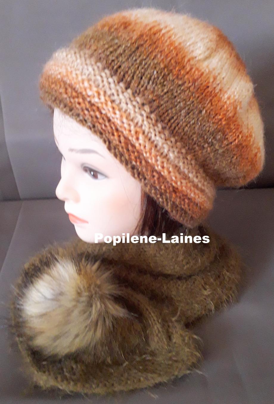 Ensemble bonnet et écharpe doublée Le bonnet est tricoté au point de godron et jersey, il est doublé sur la hauteur du point godron. L'écharpe , tricotée en laine polaire, agrémentée d'un pompon imitation fourrure, est un tour de coude 80cms de long Marque Yarns, qualité Alpaca Mohair : 20% alpaca, 55% acrylique et 25% mohair