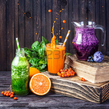 44958549-fresh-juice-and-smoothies-with-berries-fruits-and-green-spinach-on-wooden-background.jpg