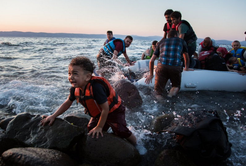 Child refugee arrives by boat.jpg