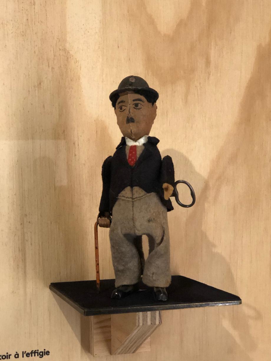 Poupée mécanique à remontoir à l'effigie de Charlot, années 1930