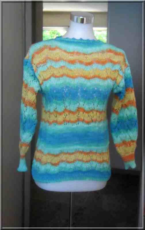Ce tout nouveau pull a été réalisé avec un coton mercerisé  100 % coton de la marque Katia .  Le point ajouré intitulé