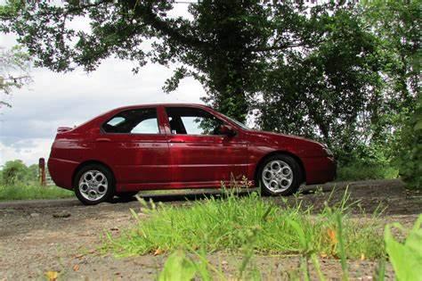 Alfa Romeo 146 Ti 1999 hollybrooksportscars com OIP
